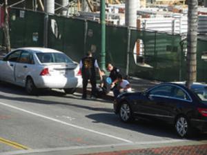cops helping car accident victim